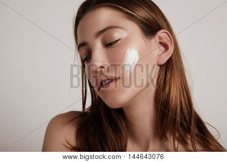 Young Blonde Woman With A Cream On Cheek