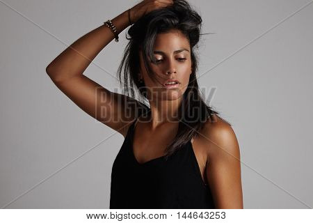 Spanish Woman Holding Hair In Hand And Watching Aside