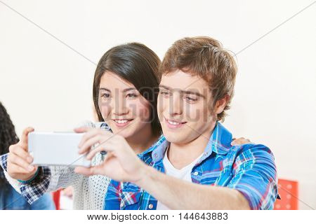 Boyfriend and girlfriend in love take a selfie