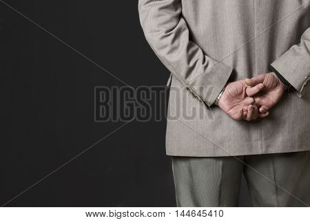 Closeup picture of professor man's hands on back. Academic of university or colleage thinking about new theory, concept or prove in studio.