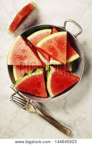 slices of watermelon on white marble background