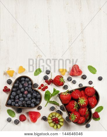 Fruits and berries on white marble background. Flat lay