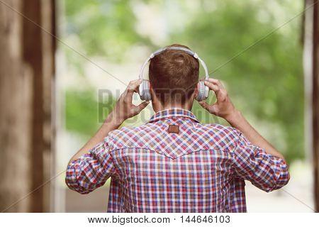 Man listening music on street