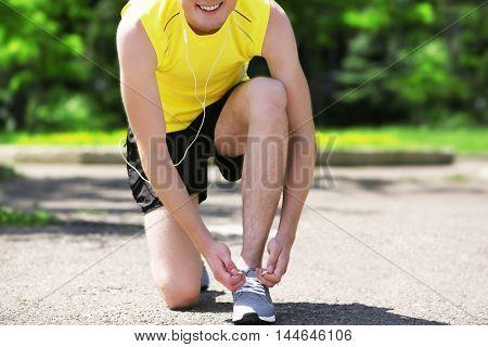 Athlete tying shoelaces
