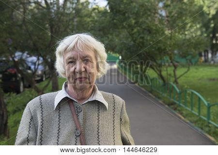 Elderly woman in the city.