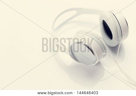 Headphones for music sound. View with copy space for your text. Retro toned