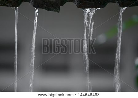 Motion drops of water rain from roof soft focus water : Blur blurred background