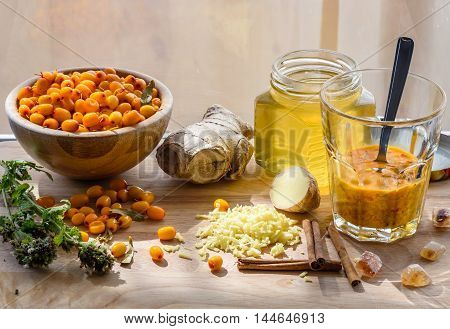 Squeezed Sea-buckthorn Berries In Glass With Other Ingredients For Healthy Tea