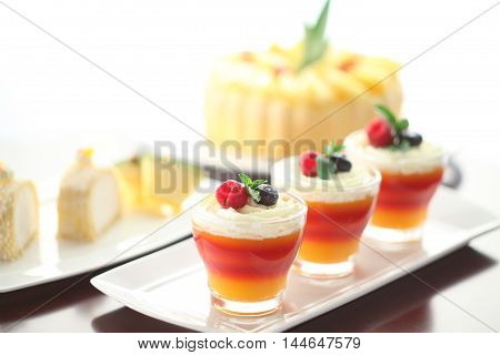 The season of passion fruit and Hawaiian style of dessert with sweet cream on white platter