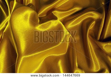 Texture gold satin cloth with the image of heart