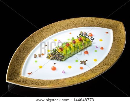 King crab and avocado cannelloni citrus and vanilla on oval platter