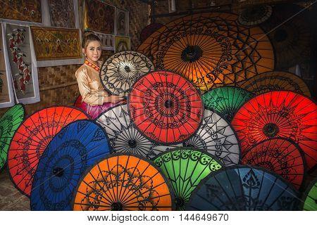 Asian Women in Colorful Umbrella Souvenier Shop at Bagan, Mandalay, Myanmar