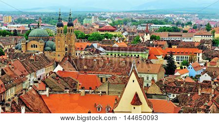 Top view of Sibiu old town. Terracotta roofs and orthodox cathedral of the city