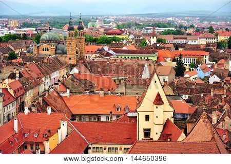 Top view of Sibiu city centre roofs and cathedral Romania