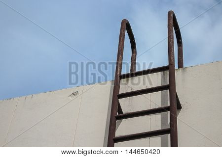 stair metal rusted industrial. Staircase to Water tank no safety rails.. sky background with copy space.