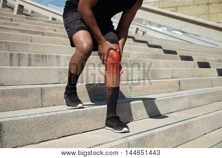 Sports And Physical Injury Concept. Cropped Shot Of African Jogger In Black Sportswear And Running S