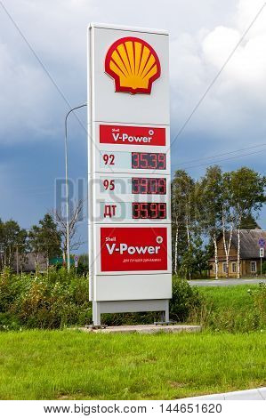 LENINGRAD REGION, RUSSIA - JULY 31 2016: Guide sign indicated the price of the fuel on the gas station Shell. Shell is an Anglo-Dutch multinational oil and gas company