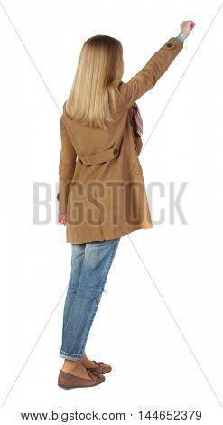 Back view of business woman. blonde in a brown cloak, stretched out his hand up.