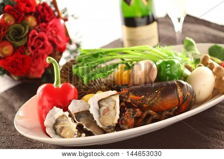 Platter of fresh seafood with oyster lobster clams chili mushroom and wine