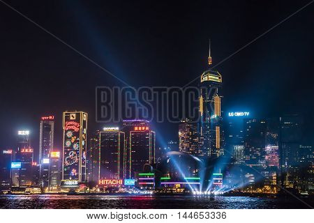 HONG KONG, CHINA - DEC. 31 2013: Nightview of Victoria Harbour in Hong Kong. (Hong Kong Island side view from Tsim Sha Tsui)