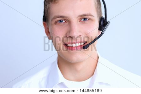 Call center male operator isolated on gray background