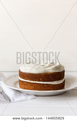 Moist double layered orange cake with white chocolate frosting