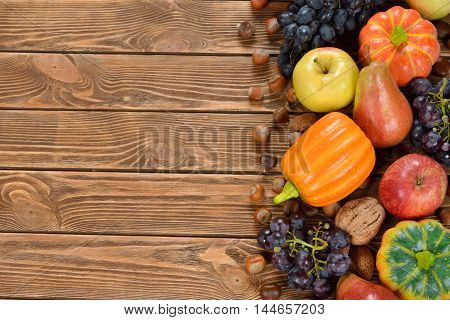 Autumn harvest on a brown background close up
