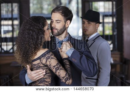 Man Looking At Tango Dancers Performing Together