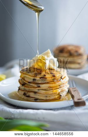Fluffy chocolate chip pancakes with drizzling honey