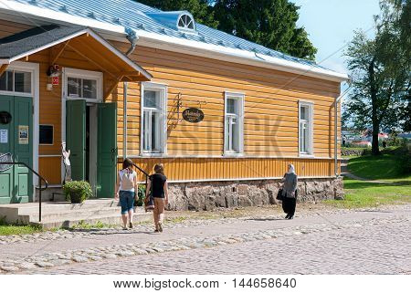 LAPPEENRANTA, FINLAND - AUGUST 8, 2016: People near Majurska Cafe in Willmanstrand Fortress last territory. House was built in the mid 18th as a residential building for the families of the officers