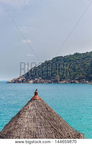 Wooden hut on a rocky beach in Thailand