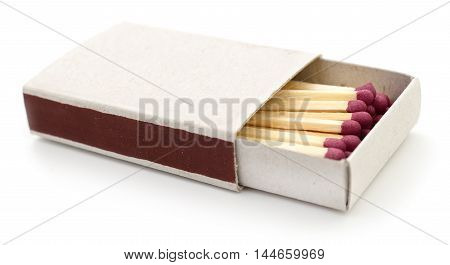 Matches in a matchbox on white background.