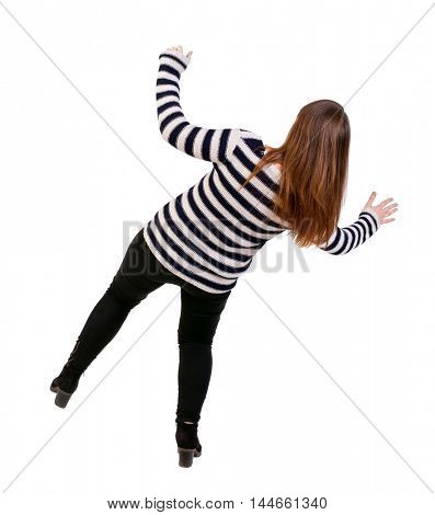 Balancing young woman. Girl in a striped jacket falls balancing on his left leg.