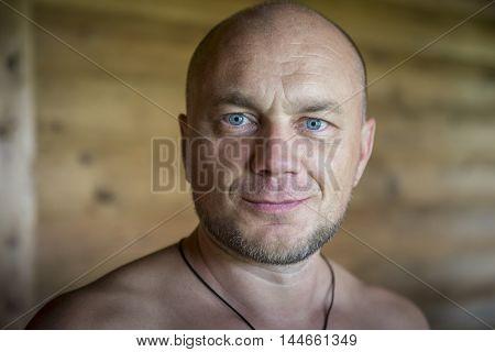 Portrait of a smiling bald man