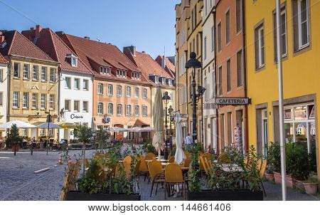 OSNABRUCK, GERMANY - AUGUST 25, 2016: Outdoor cafe Restaurants with colorful facades in Osnabruck, Germany