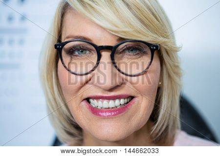 Portrait of beautiful woman wearing spectacles in optical store