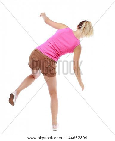 Balancing young woman. or dodge falling woman. Isolated over white background. Sport blond in brown shorts balancing on one leg.