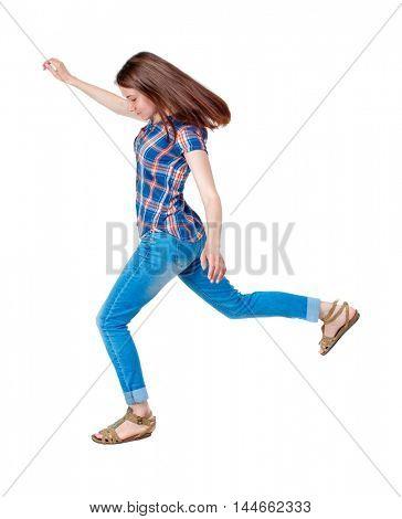 Balancing young woman. or dodge falling woman. Girl in plaid shirt jumping.
