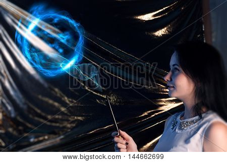 Girl With Magic Wand Brunette-the Sorcerer's Apprentice, On A Gold Background, Uses The Spell