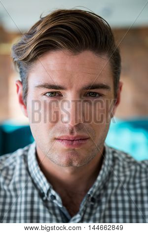 Close-up of a handsome man looking at camera
