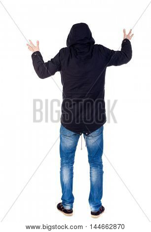 Back view of man. Raised his fist up in victory sign. Rear view people collection. guy with a hood on his head while wearing someone scary.
