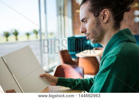Man looking at menu in cafeteria