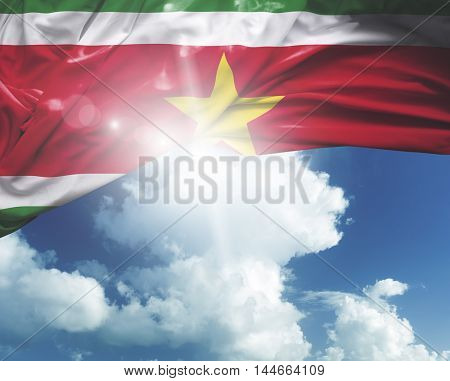 Suriname flag on a beautiful day