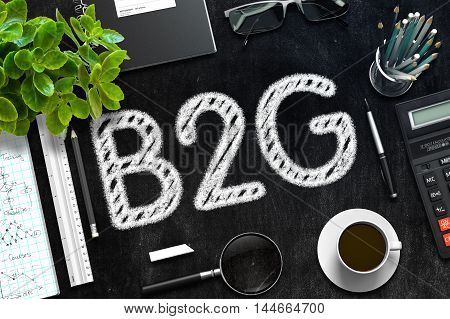 Business Concept - B2G Handwritten on Black Chalkboard. Top View Composition with Chalkboard and Office Supplies on Office Desk. 3d Rendering. Toned Image.