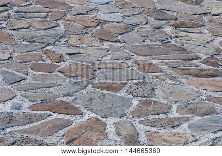 Background of stone. Abstract background. Natural stone. Stone road.
