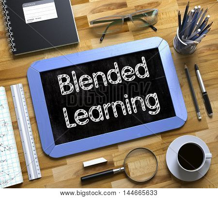 Blended Learning on Small Chalkboard. Business Concept - Blended Learning Handwritten on Blue Small Chalkboard. Top View Composition with Chalkboard and Office Supplies on Office Desk. 3d Rendering.