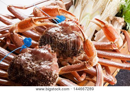 Fresh raw red king crab for meal on the table with mushroom in restaurant
