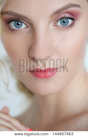 Lovely girl with blue eyes in close-up
