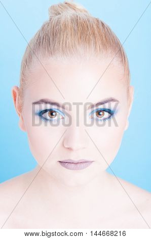 Portrait Of Blond Girl With Blue Eyeshadow Make-up