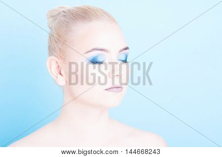 Girl Posing With Eyes Closed And Blue Eye Make-up